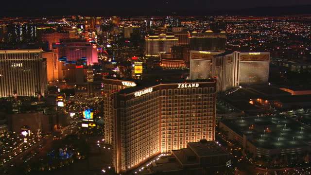 night flight above casinos along the strip with wide view of glittering las vegas - artbeats stock videos & royalty-free footage