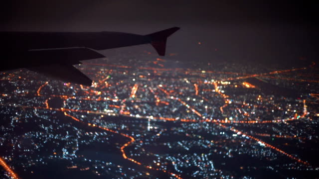 Night Flight Airplane Wing and City
