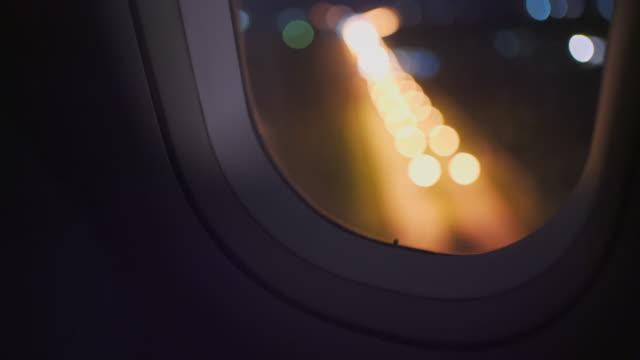 night flight before landing. taken in shallow defocused - nightlife stock videos & royalty-free footage
