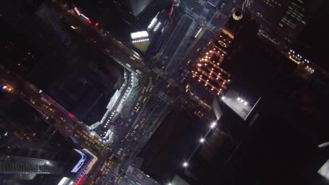 Night flight over 45th Street, looking down at Times Square. Shot in 2005.