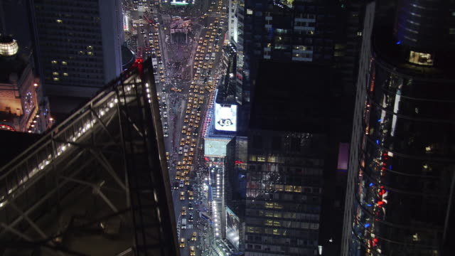 Night flight over Broadway and Seventh beyond Times Square. Shot in 2005.