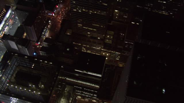night flight over new york city . shot in 2005. - artbeats stock videos & royalty-free footage