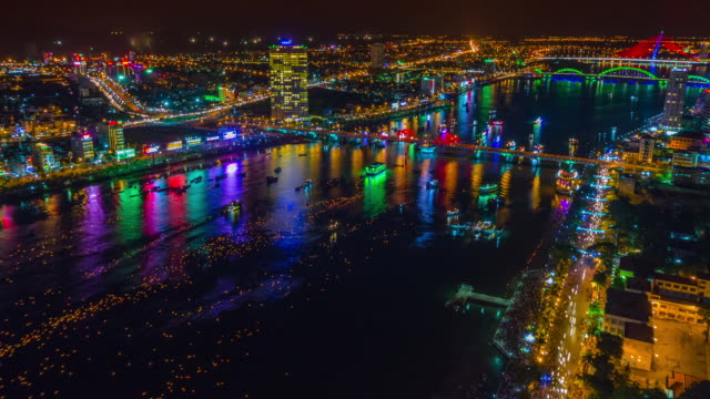 night floating candles on the han river. danang, central vietnam, asia - ダナン点の映像素材/bロール