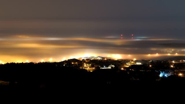 night fog over a city, timelapse - stratus stock videos & royalty-free footage