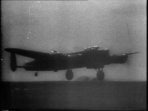 night footage of halifax and lancaster bombers taking off from airfield / map of cities in italy that are their destination - lancaster bomber stock videos & royalty-free footage