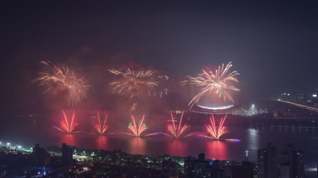 night han river's fireworks display for opening ceremony of korean national athletic competition at jamsil sports complex / seoul, south korea - river han stock videos & royalty-free footage