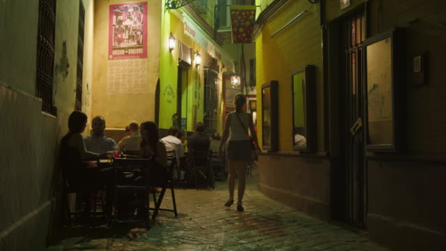 WS night in one of the alleys of Barrio Santa Cruz people enjoying tapas and drinks on outside tables