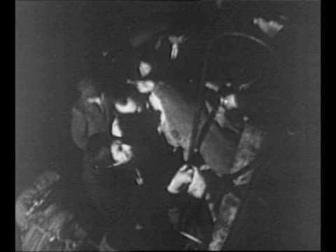 jewish refugees walk on gangplank with bundles of belongings / man on ship pulls bundle onto ship from men below / montage refugees on boat boarding... - 1948 stock-videos und b-roll-filmmaterial