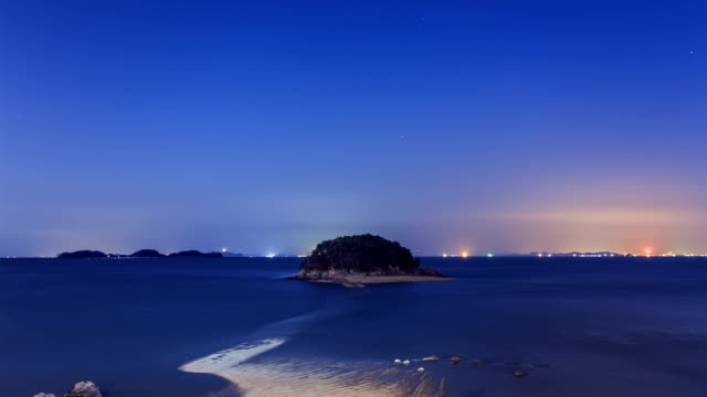 night landscape of mokseom(natural landmark) in seonjaedo island at low tide - natural landmark stock videos & royalty-free footage