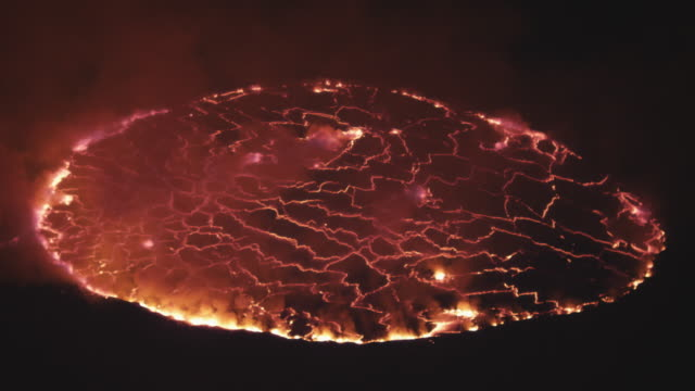 night, lava lake glowing in dark, nyiarogongo, democratic republic of congo, sep 2011 - lava stock videos & royalty-free footage