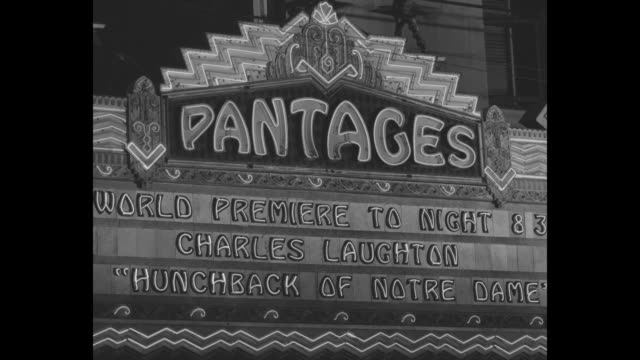 lighted marquee of Pantages Theatre in Los Angeles announces the world premiere of 'The Hunchback of Notre Dame'