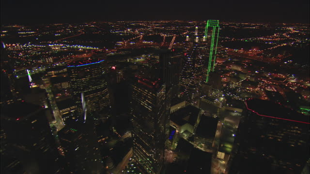 Night low altitude oblique aerial of downtown Dallas core to reveal Reunion Tower