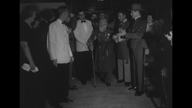 vidéos et rushes de man and woman assist an elderly confederate veteran as they approach camera / young adult in dinner jacket and two boys in confederate army uniforms... - élevé