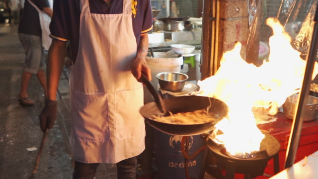 night market cooking style at yaowarat street food at china town, bangkok - food stock videos & royalty-free footage