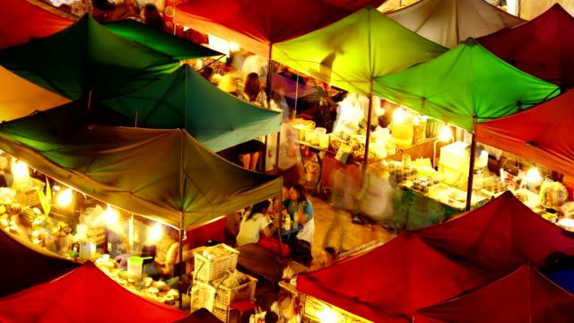 vídeos de stock e filmes b-roll de noite de mercado - mercado noturno