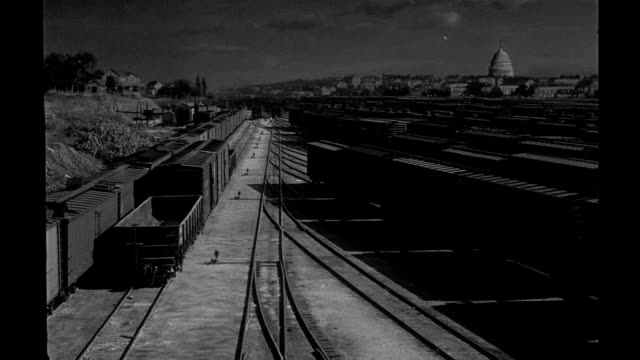 HA night matte special effects train cars freight cars stored in rail yard Matte special effects rail yard at night on January 01 1940