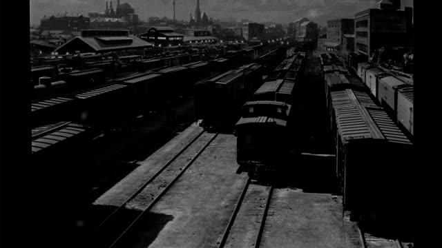 HA night matte special effects train cars freight cars stored in rail yard matte special effects rail yard on January 01 1940