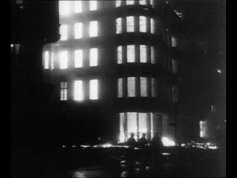 montage buildings burn after attack by soviet military on berlin during world war ii / from greatest headlines of the century series - 1945点の映像素材/bロール