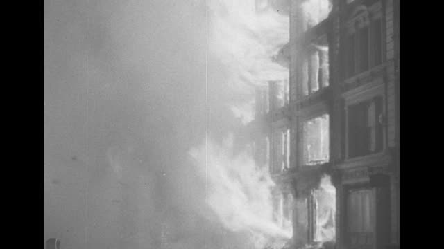 montage firefighters walk aim hoses at fires burning in london after nazi air raids during the blitz of world war ii / montage ls down street with... - the blitz stock videos and b-roll footage