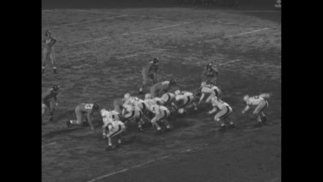 new york giants kick off to eastern college all-stars in game at the polo grounds; #52, jack lee of carnegie tech, returns ball to giants' territory... - アメフト ファーストダウン点の映像素材/bロール