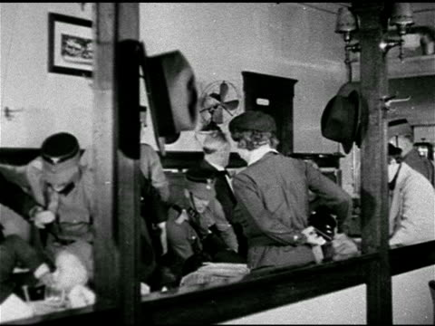 'nazi mobs loot burn murder' 'night of terror for jews in re' mot 1935 dramatization german nazi soldiers rousting office workers fighting owners in... - ナチズム点の映像素材/bロール