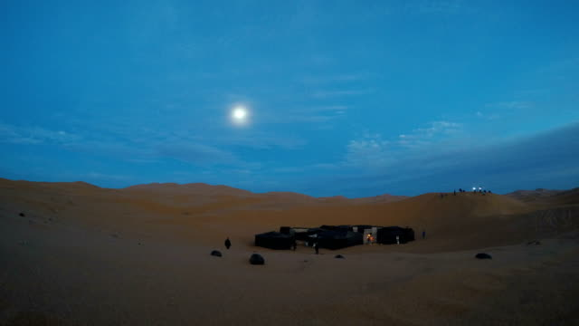 night on the desert. view at desert camp. full moon - sand dune stock videos & royalty-free footage
