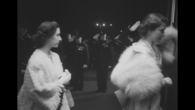 princess elizabeth precedes princess margaret as they enter the odeon theatre for the command performance of the forsyte saga military officer... - 1949 stock videos and b-roll footage