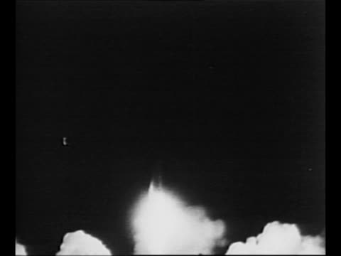 propulsion system of rocket fires with vo smoke billows around base of rocket missile with payload launches from cape canaveral fl tilt up as rocket... - stapellauf stock-videos und b-roll-filmmaterial