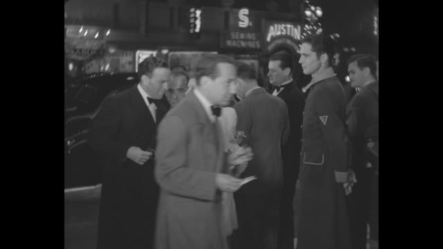 radio stars george burns and gracie allen hesitate before approaching the theater entrance for the los angeles premiere of 'the hunchback of notre... - hollywood california stock videos & royalty-free footage