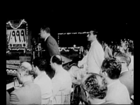 rear shot egyptian president gamal abdel nasser waves from balcony / ws soldier with egyptian flag on platform as crowd surrounds faces camera /... - president of egypt stock videos & royalty-free footage