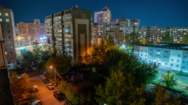 night, residential sleeping area in the center of siberia. view of the multi-storey buildings. - russia stock videos & royalty-free footage