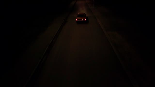 night ride. aerial view - horseless carriage stock videos & royalty-free footage
