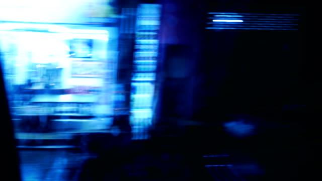 vídeos de stock, filmes e b-roll de passeio a noite no centro da cidade. movimento desfocado - perspectiva do passageiro