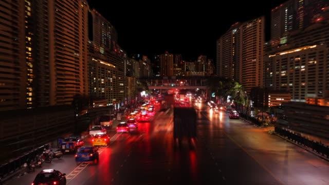 stockvideo's en b-roll-footage met night road and skyscraper - commercieel landvoertuig