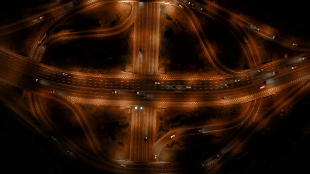 vídeos de stock e filmes b-roll de night road junction: set of 3 variations from aerial drone timelapse - road junction