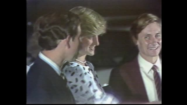 night royal car arrives – prince charles and princess diana out of car and greet south australian premier john bannon and others – couple into... - anno 1983 video stock e b–roll