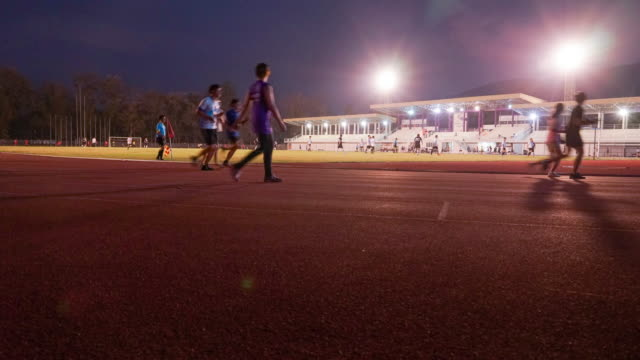 night run in track - timelpase - sports track stock videos & royalty-free footage