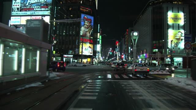 pov, night scene at susukino crossing, sapporo, japan - western script stock videos & royalty-free footage