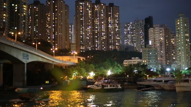night scene in aberdeen, hong kong, china. - aberdeen hong kong stock videos & royalty-free footage