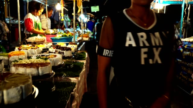 night scene of night market unidentified people lacals and tourists.people shopping for lacal foods and goods. - night market stock videos & royalty-free footage