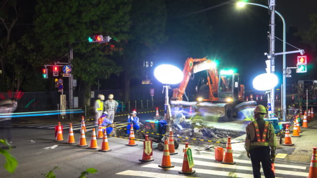 night scene of road repair constructions site in tokyo at night. - construction site stock videos and b-roll footage