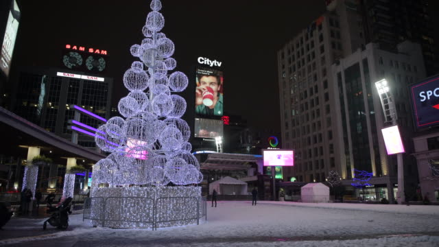 night scene of the famous yonge-dundas square, with a traditional christmas tree illuminated in the town square, in the downtown district, ontario,... - toronto stock videos & royalty-free footage