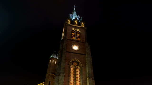 night scenery of a bell tower of myeong dong cathedral - bell tower tower stock videos and b-roll footage