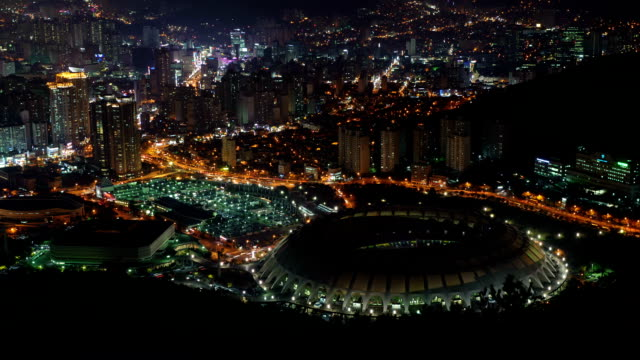 night scenery of building and traffic moving near the main stadium of busan asiad - busan stock videos & royalty-free footage
