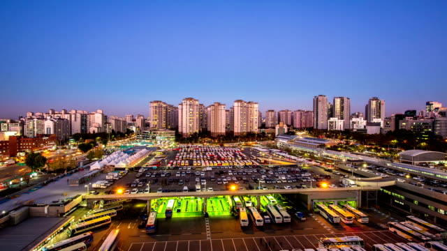 Night scenery of Bus station and cityscape