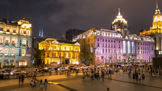 Night Scenery of HSBC Building and Custom House with crowd at The Bund area
