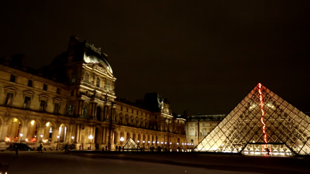 night scenery of louvre museum in paris, france - louvre stock videos and b-roll footage