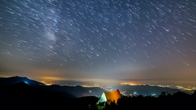 night scenery of 	manbokdae peak with	bivouacking at chirisan national park behind milky way - tent stock videos & royalty-free footage