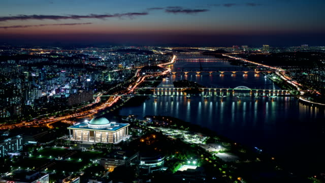 night scenery of national assembly building and city buildings near han river / yeouido, seoul, south korea - 電飾点の映像素材/bロール