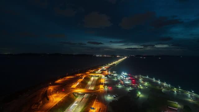 night scenery of sihwa narae rest area and traffic on sihwa seawall road / ansan-si, gyeonggi-do, south korea - light trail stock videos & royalty-free footage